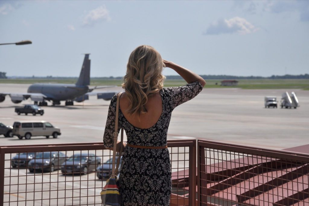 woman looking at aeroplanes
